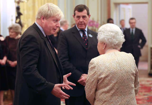 The Queen speaks to Foreign Secretary Boris Johnson, left (Jonathan Brady/PA)
