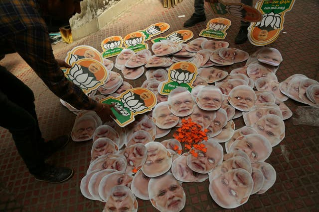 India's opposition Bharatiya Janata Party workers prepare to distribute election campaign material in Jammu