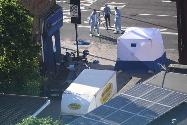 Forensic officers examine the van used in the attack (Victoria Jones/PA)
