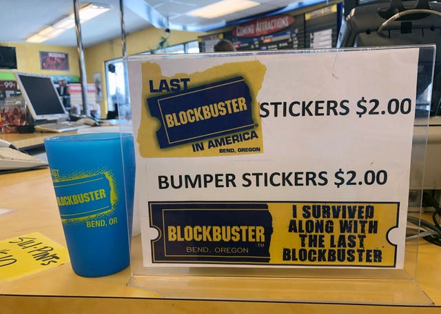 A sign advertising locally made souvenirs from the last Blockbuster store on the planet