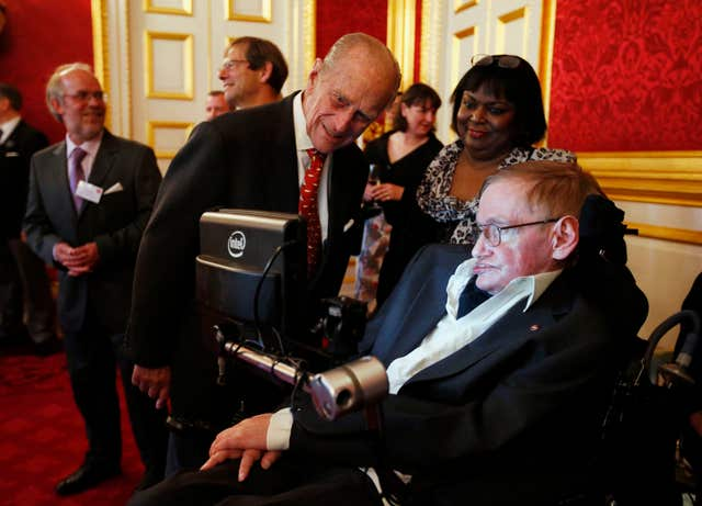 The Duke of Edinburgh greets Professor Stephen Hawking during a reception for Leonard Cheshire Disability in the State Rooms, St James's Palace, London (PA)
