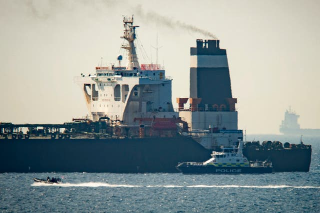 A Royal Marine patrol vessel beside the Grace 1 supertanker in Gibraltar