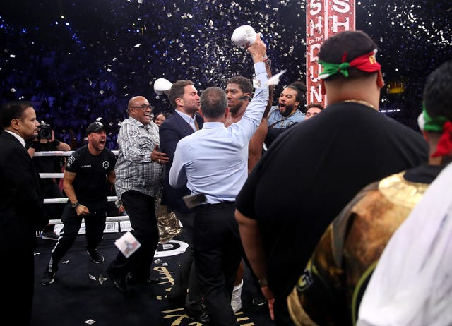Joshua's promoter Eddie Hearn celebrated wildly with the boxer's team