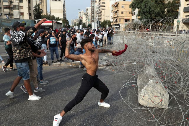 Protesters throw stones in Beirut