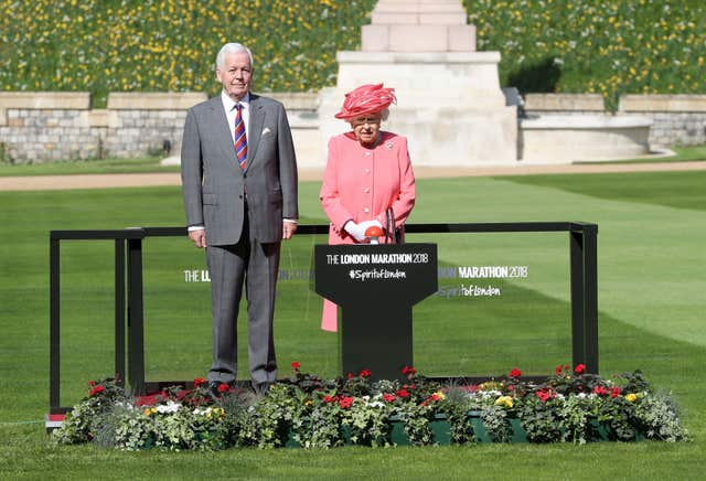 The Queen with Sir John Spurling, chairman of London Marathon Events Ltd, before she pressed a button in Windsor Castle, Berkshire to start the London Marathon (Chris Jackson/PA)