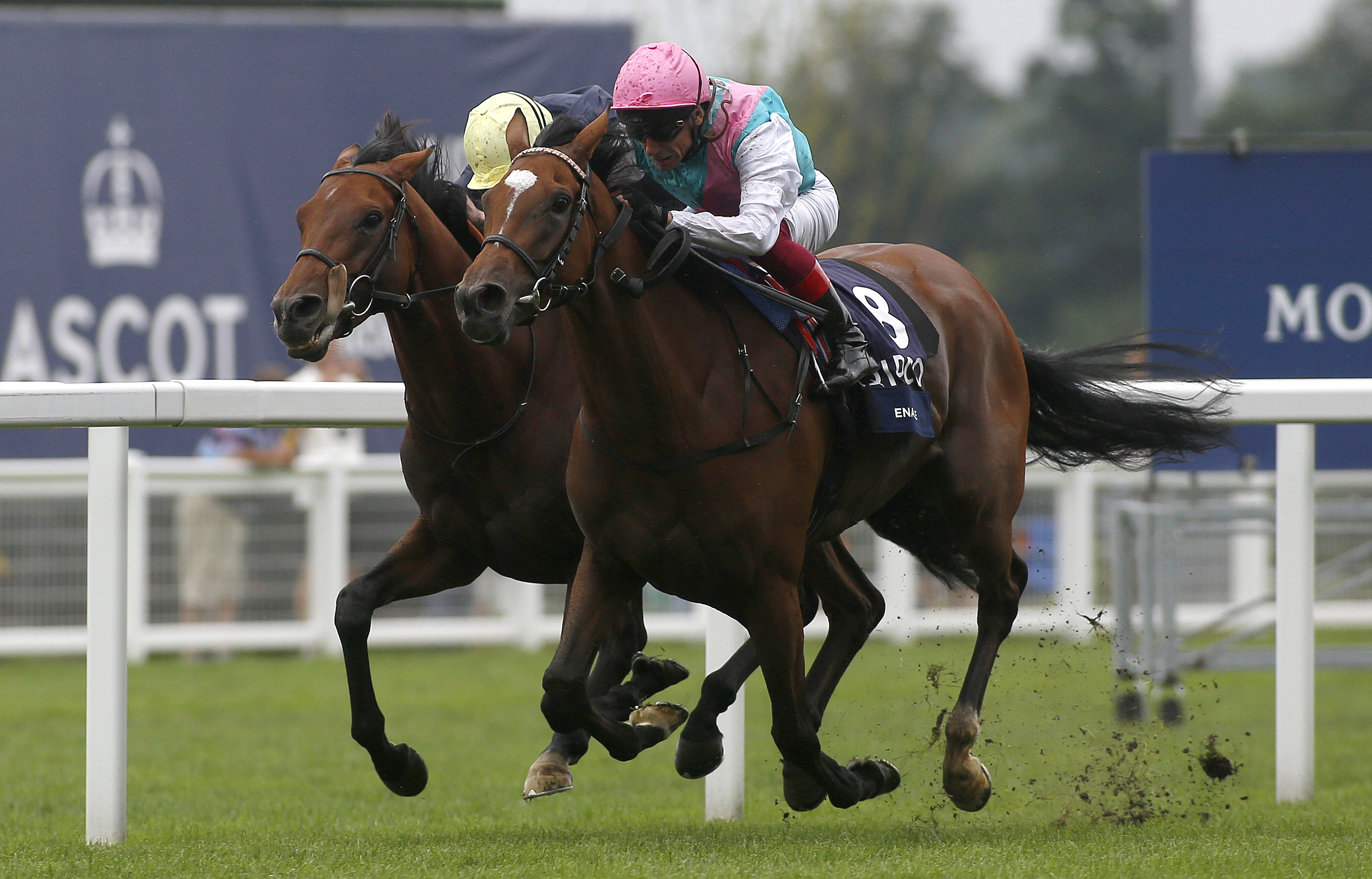 Enable and Frankie Dettori (right) get the better of Crystal Ocean in the King George