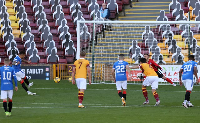 Rangers' James Tavernier scores from the spot against Motherwell