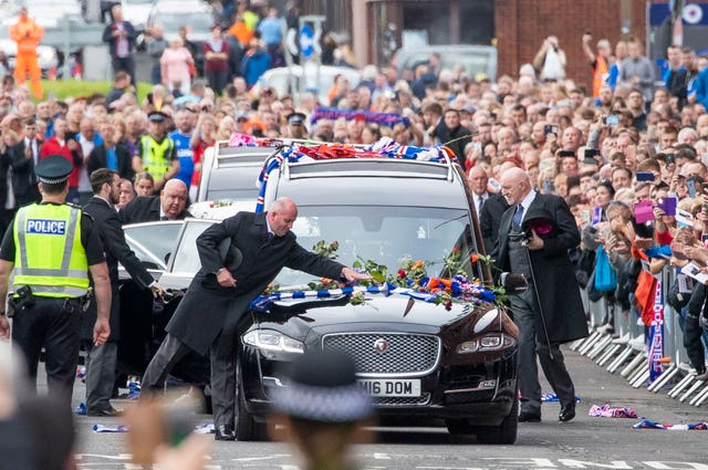 Thousands gathered outside Ibrox for the funeral procession of  Fernando Ricksen