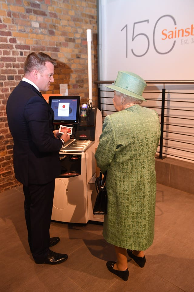 Queen visits Sainsbury's anniversary model.