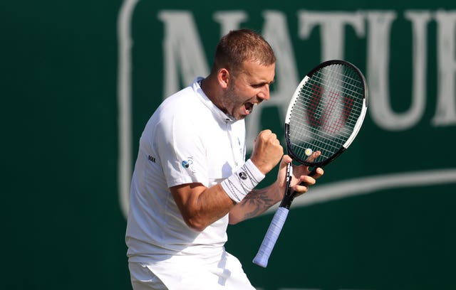 Dan Evans reacts after winning the match