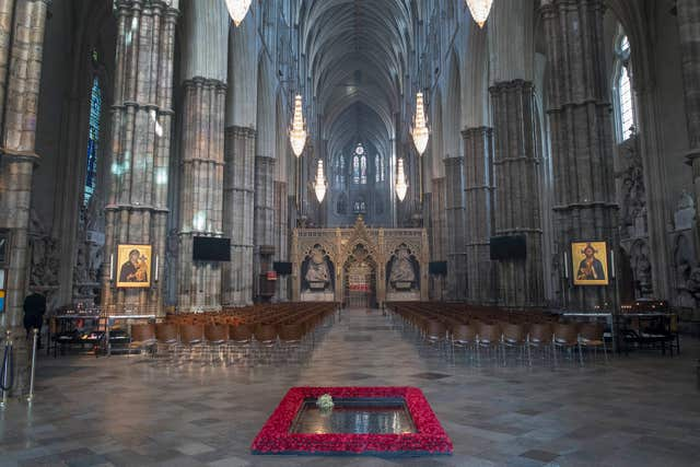 The grave is marked out by poppies in Westminster Abbey (Victoria Jones/PA)