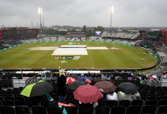 Grey skies and umbrellas were a common sight during the first semi-final