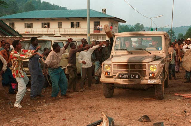 Rwandan Hutus give the departing French troops the thumbs-up as the French army pull out of Cyangugu, in south-west Rwanda in 1994