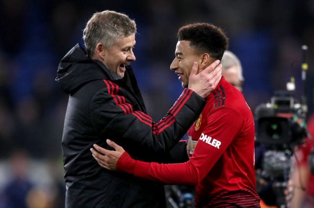 Ole Gunnar Solskjaer congratulates Jesse Lingard after the win over Cardiff (Nick Potts/PA).