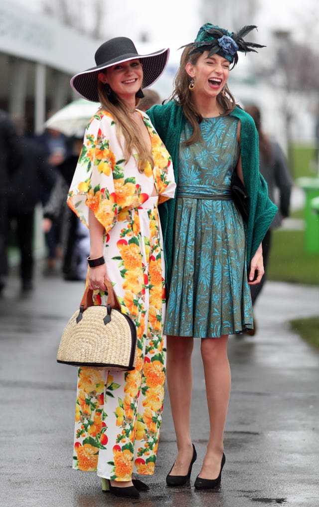 Bright outfits cheered up a wet day at Aintree (David Davies/PA)