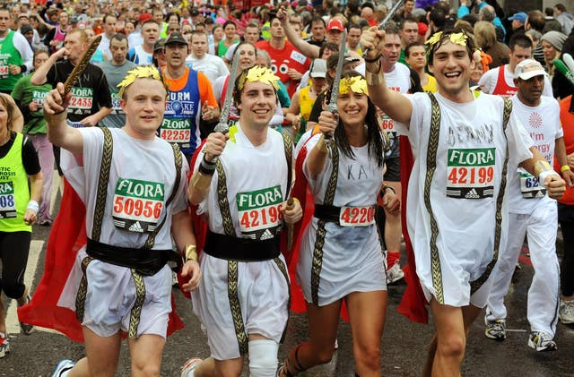 A group of funrunners cross Tower Bridge during the London Marathon 2008