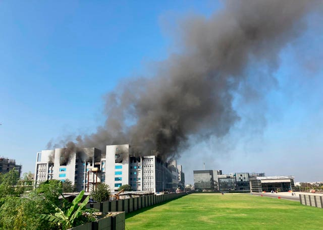 Smoke rises from the Serum Institute of India, the world's largest vaccine maker, in Pune