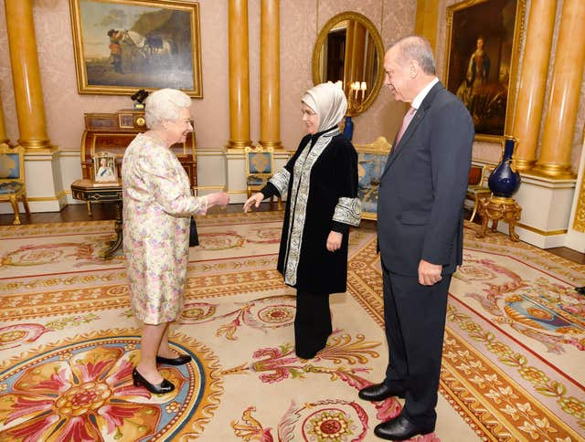 President of Turkey Recep Tayyip Erdogan and his wife Emine meet the Queen at Buckingham Palace (John Stillwell/PA)