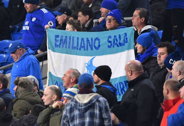 Cardiff fans hold aloft a banner in tribute to Sala