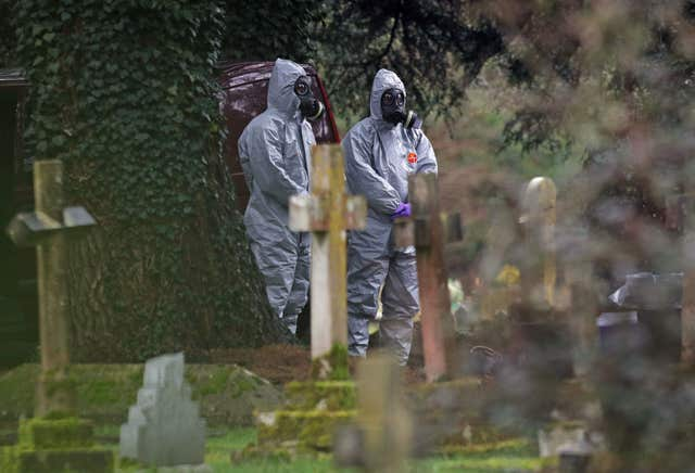 Forensic officers in gas masks at the London Road cemetery during the Salisbury incident (Andrew Matthews/PA)
