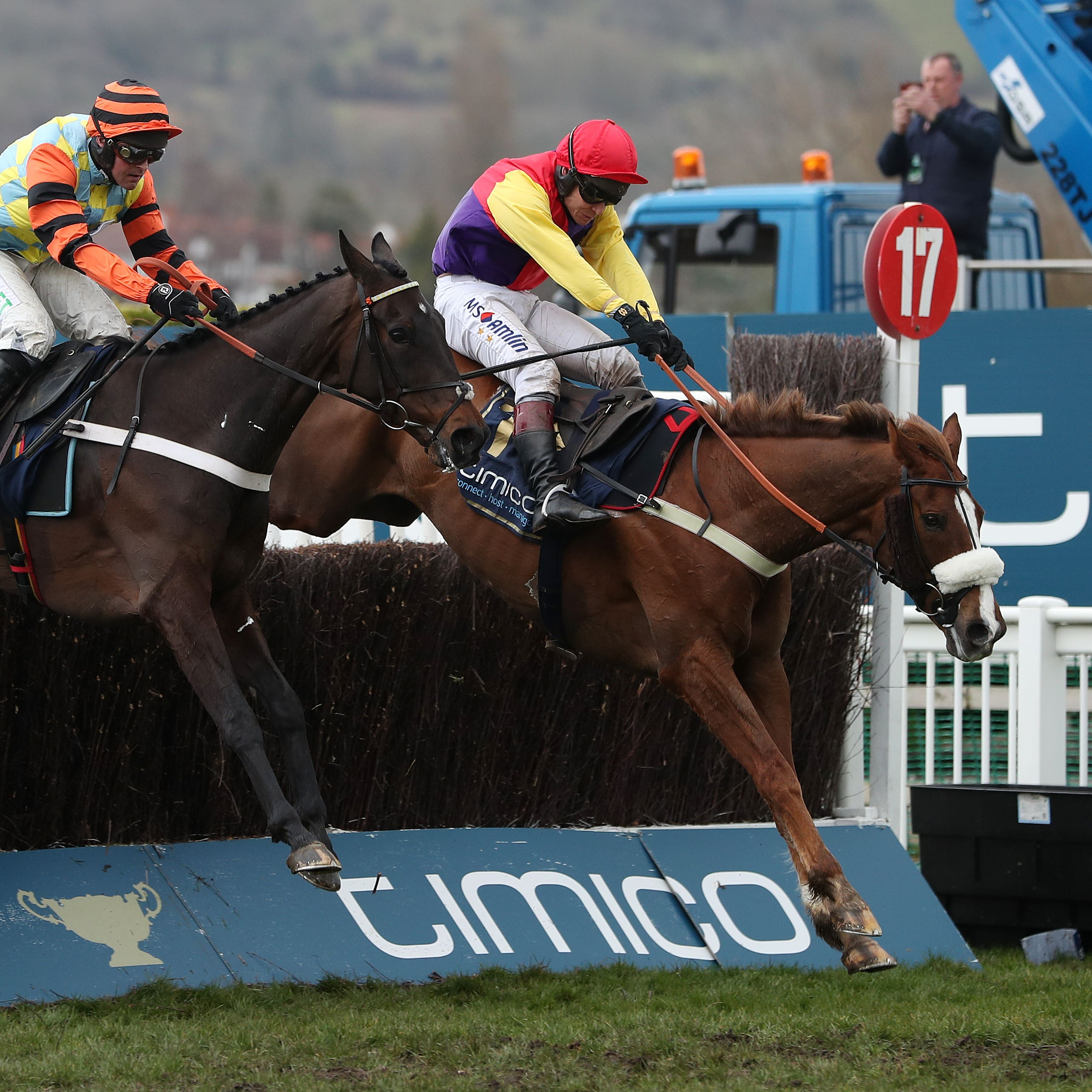 Native River (right) jumps the last ahead of Might Bite to win the Cheltenham Gold Cup