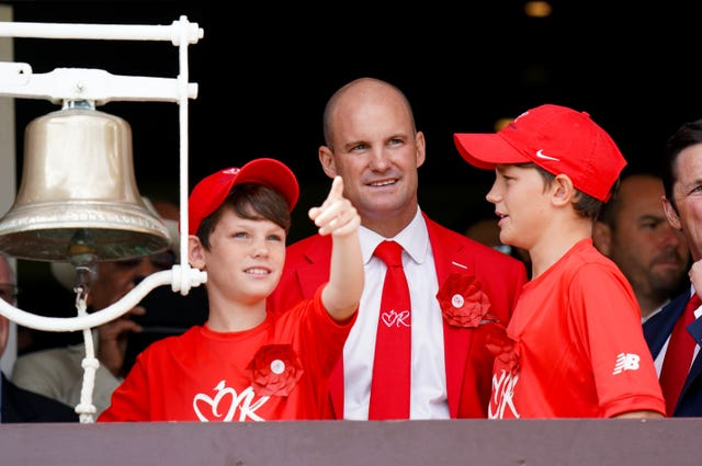 Andrew Strauss rang the bell to start day two with sons Luca and Sam as the ground turned red in aid of the Ruth Strauss Foundation