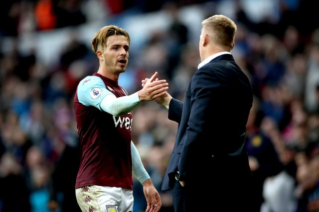 Jack Grealish, left, is congratulated by his manager Dean Smith