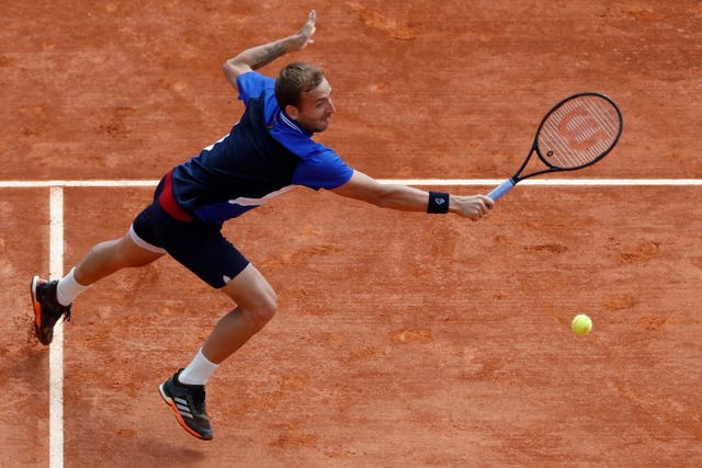 Dan Evans stretches for a backhand during his victory over David Goffin