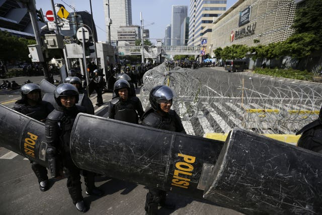 Riot police outside the Election Supervision Board in Jakarta