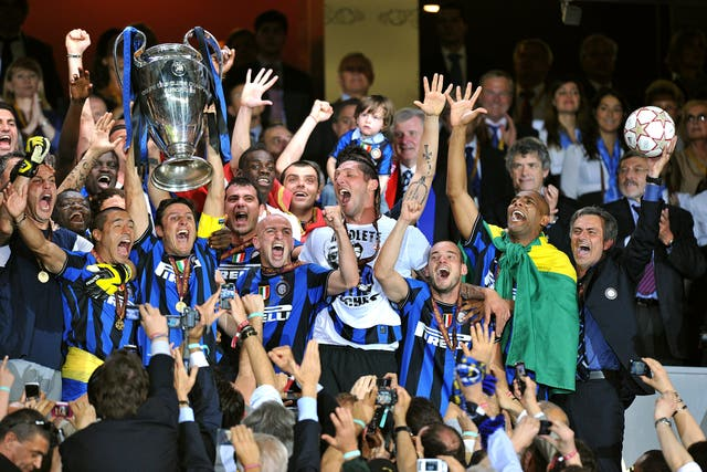 Mourinho, far right, celebrates Champions League success with Inter