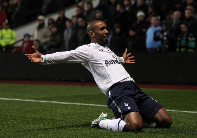 Jermain Defoe slides on his knees after scoring