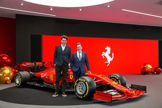 Ferrari team principal Mattia Binotto, left, and Ferrari chief executive Louis Camilleri, right, have work to do