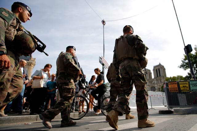 French soldiers patrol around Notre Dame Cathedral