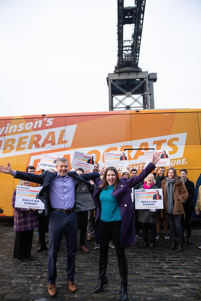 Lib Dem leader Jo Swinson with Scottish Lib Dem leader Willie Rennie in front of the Finnieston Crane in Glasgow