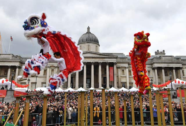 The Flying Lions performing for the crowds in Trafalgar Square (John Stillwell/PA)