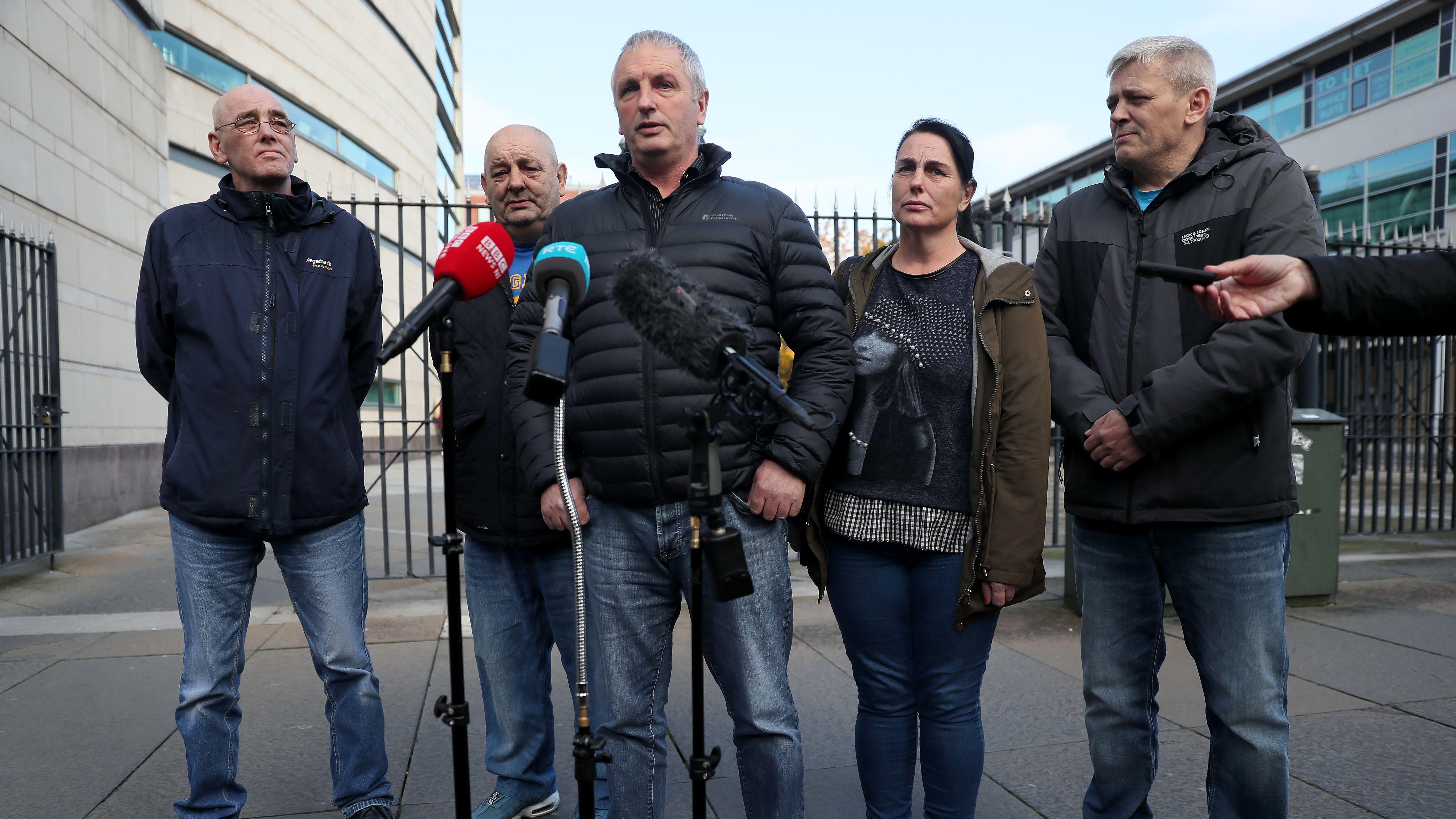 Jean McConville's children speak to the media outside Belfast Crown Court
