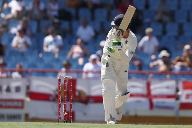 Keaton Jennings is bowled off his thigh pad