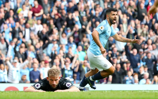 Sergio Aguero, right, celebrates as Charlie Taylor looks dejected during Manchester City's 5-0 victory over Burnley