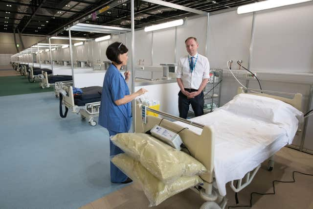 Sir Simon Stevens visited the ExCel centre in London, which is being made into the temporary NHS Nightingale hospital