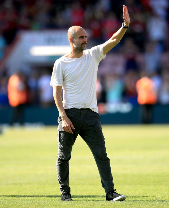 Manchester City manager Pep Guardiola acknowledges the fans