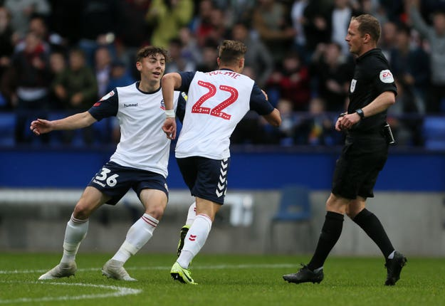Bolton's Dennis Politic celebrates opening the scoring