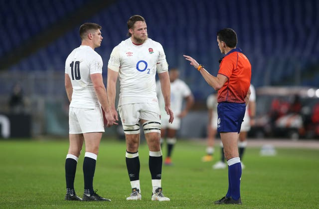 Jonny Hill, centre, is spoken to by referee Pascal Gauzere, right