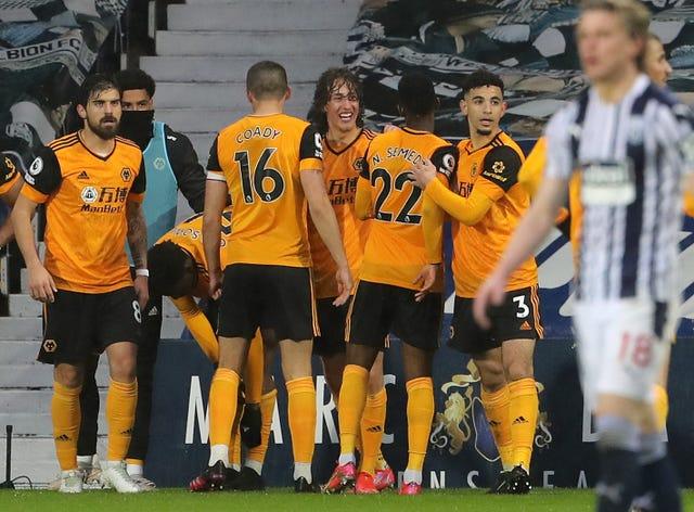 Fabio Silva (centre) celebrates scoring Wolves' opener
