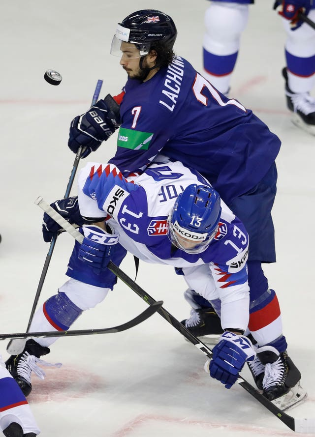 Robert Lachowicz, collides with Slovakia's Michal Kristof during Great Britain's defeat at the Ice Hockey World Championship