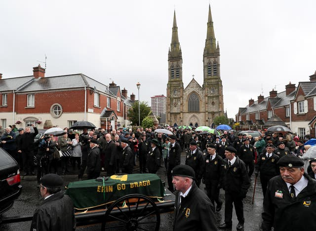 The coffin of former Provisional IRA leader Billy McKee leaves St Peter's Cathedral, Belfast