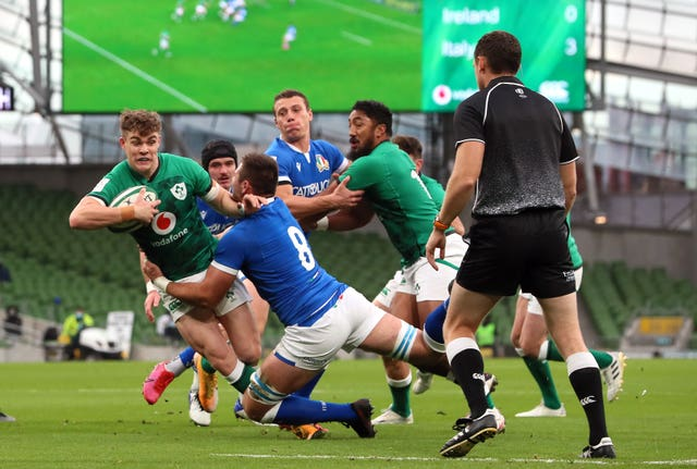 Garry Ringrose is tackled by Italy's Jake Polledri at the Aviva Stadium