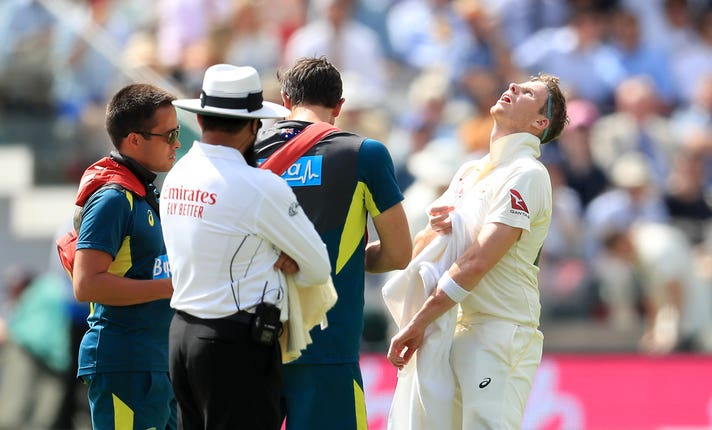 Steve Smith, right, receives treatment at Lord's
