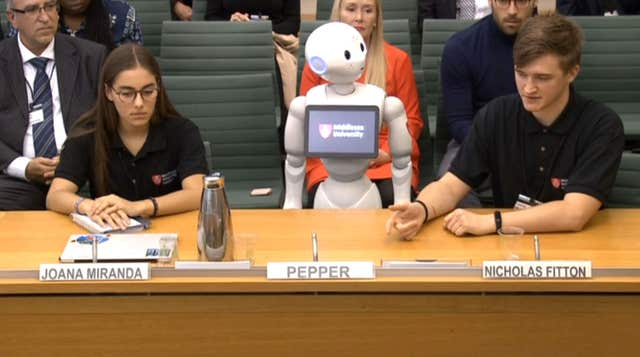 Pepper the robot, appearing before a select committee for the first time (PA )