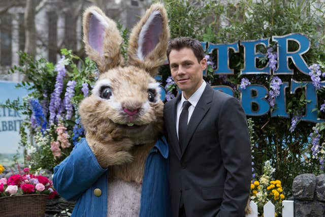 Peter Rabbit's director Will Gluck with the star of the show (Rick Findler/PA)
