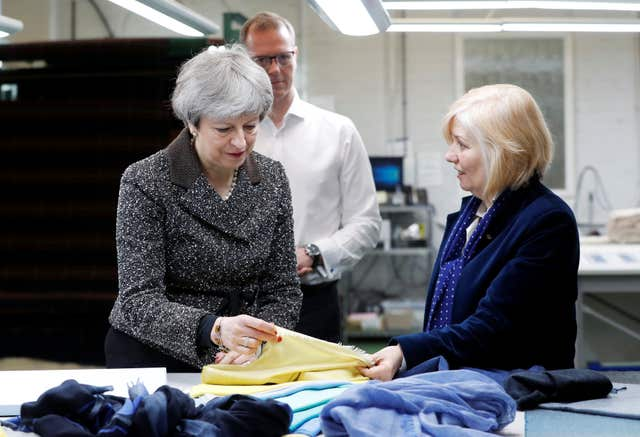 Mrs May visits textile producers Alex Begg in Ayrshire, while on a tour of the four nations of the UK (Russell Cheyne/PA)
